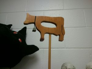 wooden cow on stand